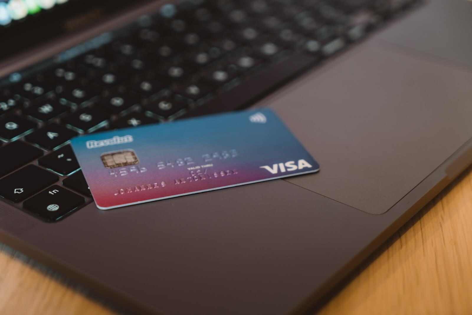blue and white visa card on silver laptop computer